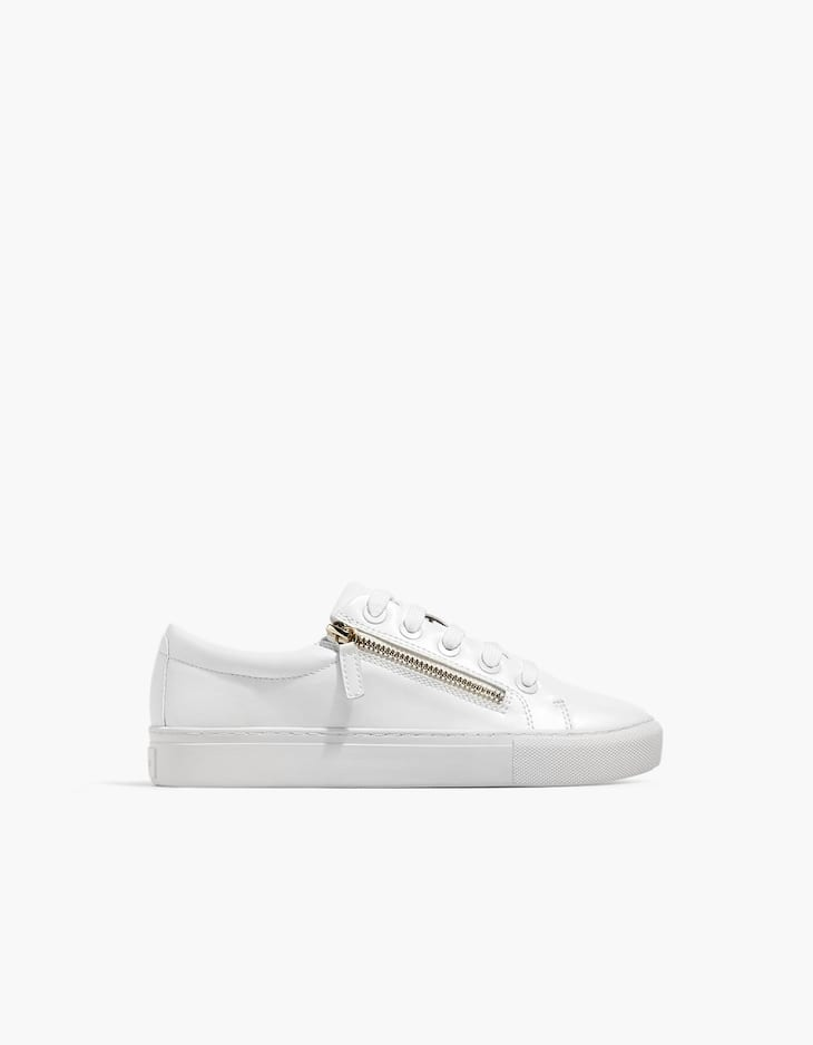 White plimsolls with zip detail