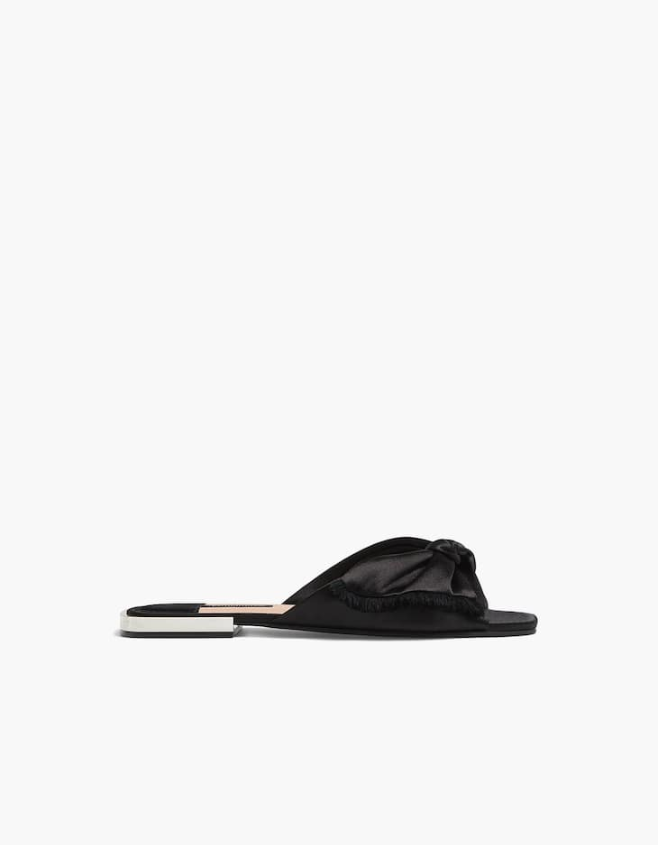 Black slides with bow