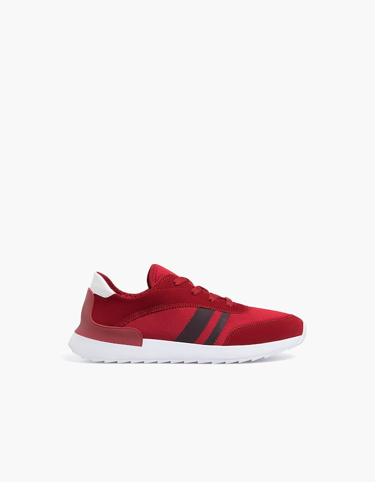 Red contrasting sneakers with leather details