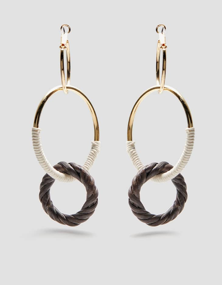 Hoop earrings intertwined with natural thread