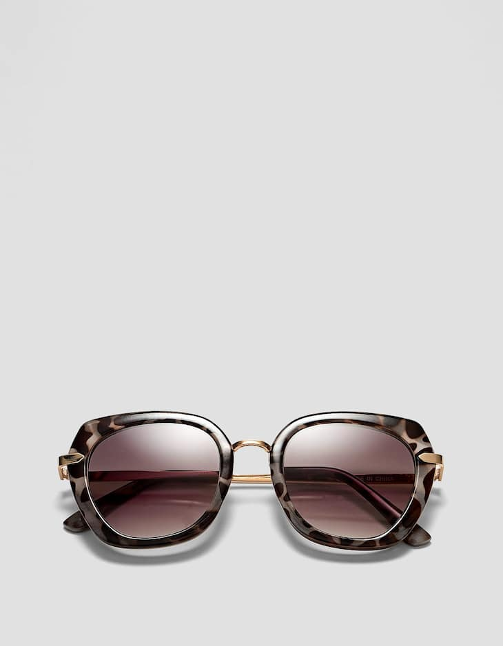 Grey tortoiseshell sunglasses with metal temples