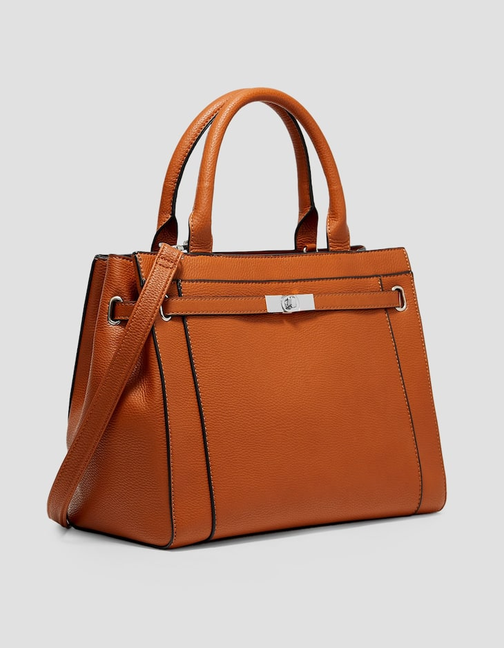 Tote with belt fastening.