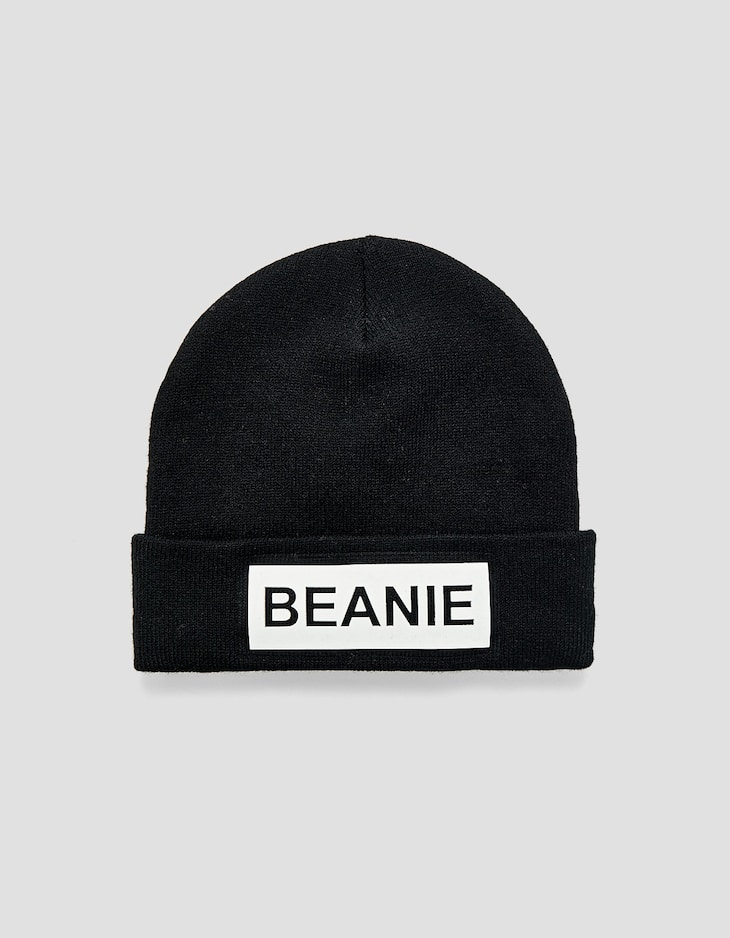 Beanie with rubberised slogan