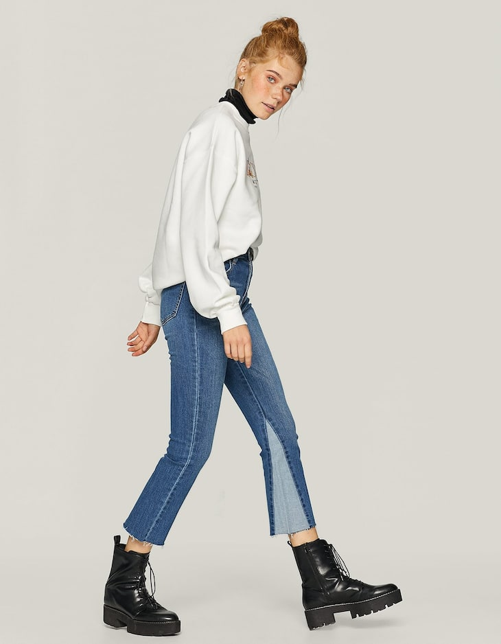Flared jeans with contrasting detail