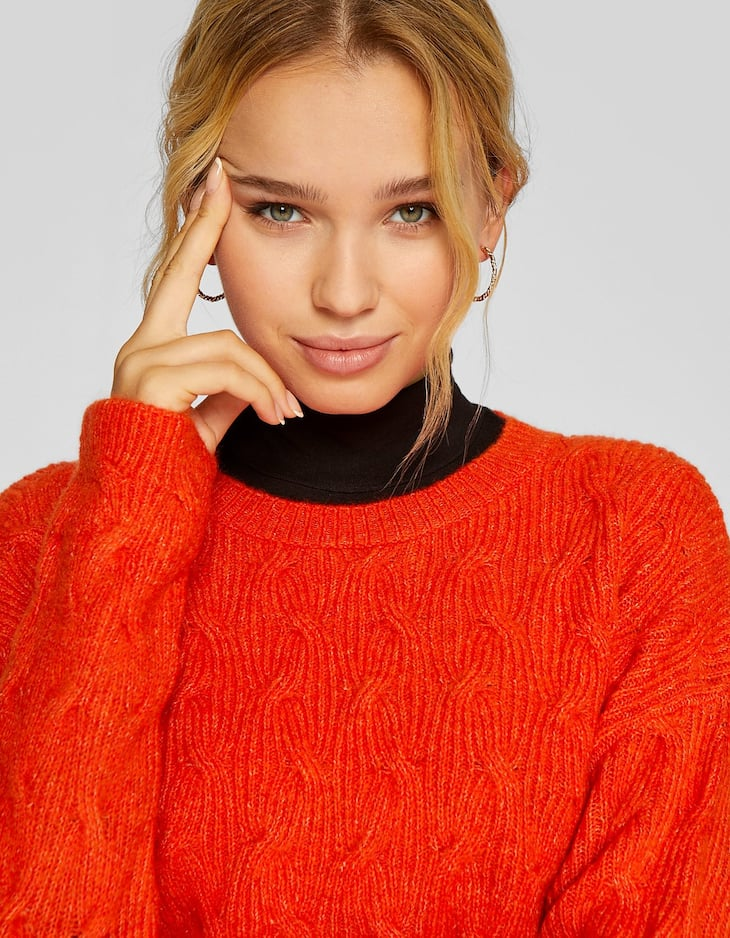Cropped sweater with cable detailing