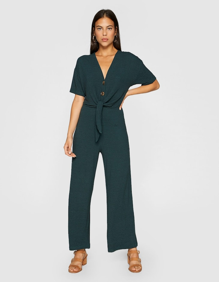 Knit jumpsuit with tie belt