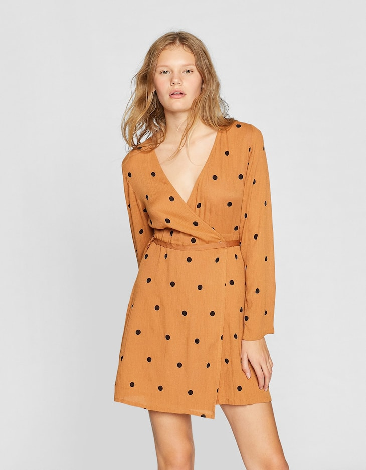 Polka dot print crossover dress