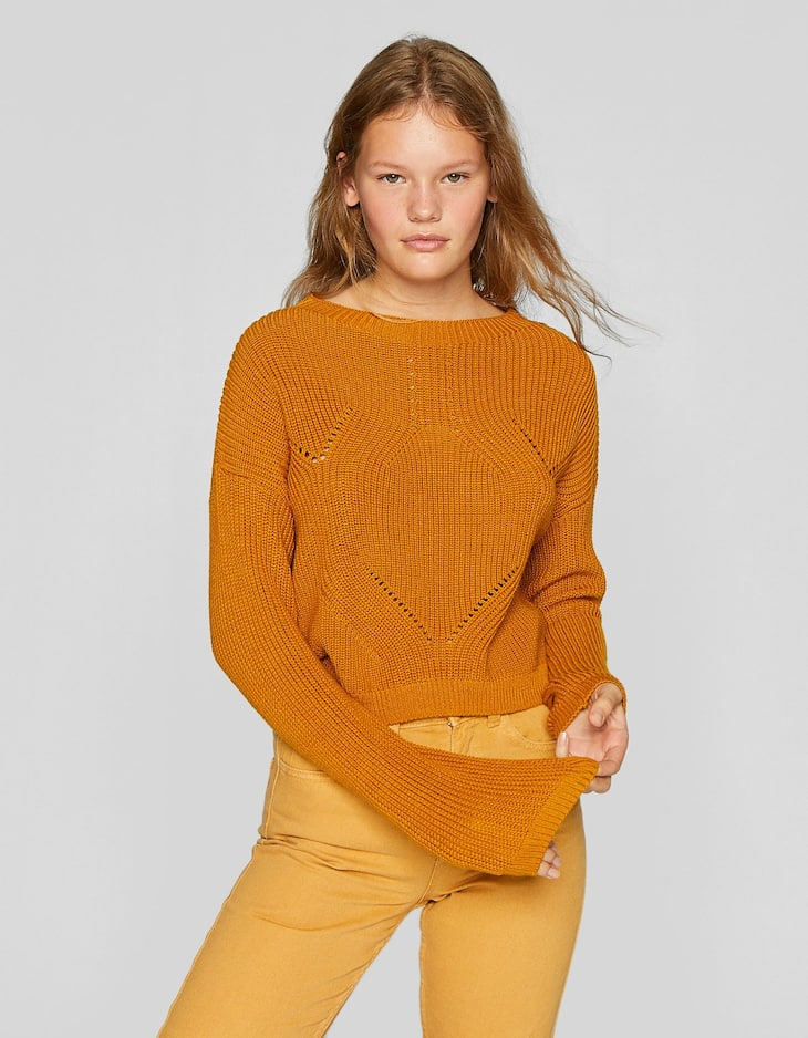 Open knit sweater with high neck