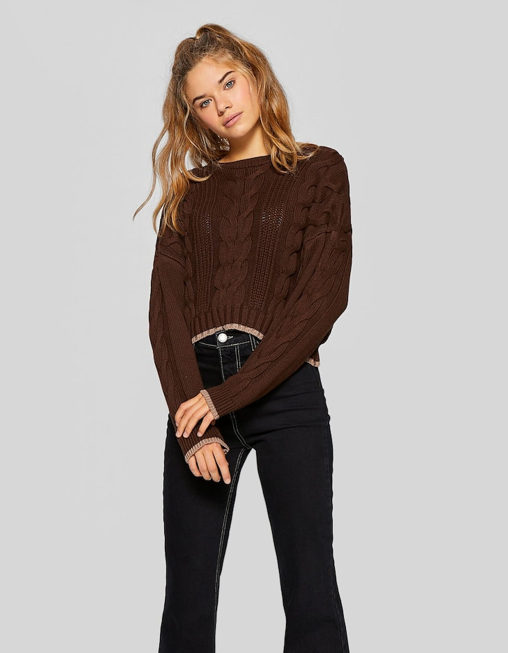 Contrasting cable-knit sweater
