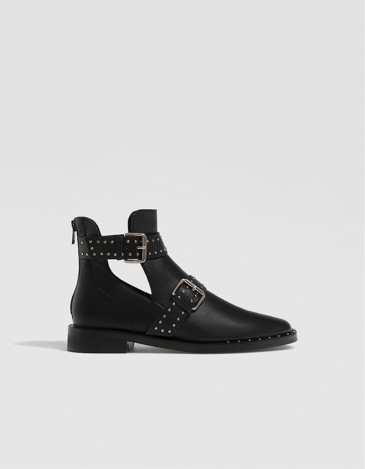 Flat LEATHER ankle boots with cut-out sides and stud details