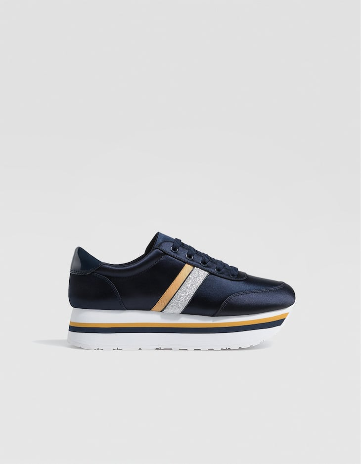 Blue contrasting platform trainers