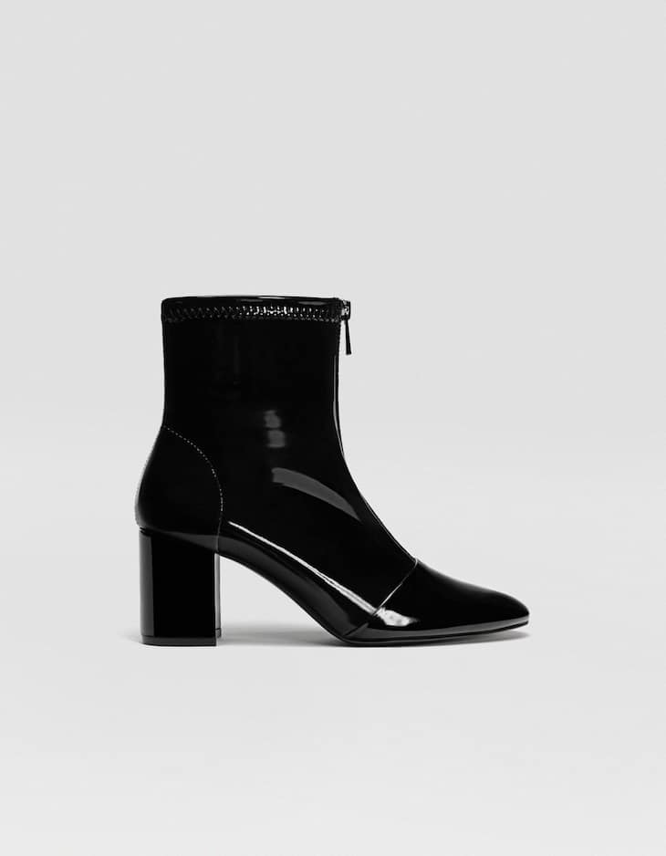 Black patent heeled ankle boots with zip detail