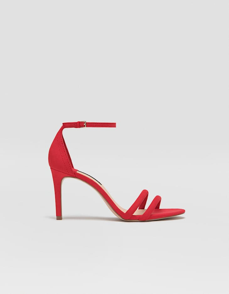Red sandals with stiletto heels