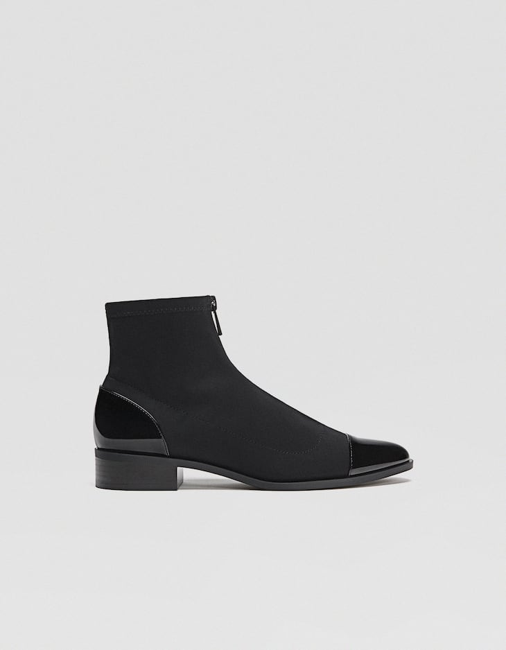 Flat black ankle boots with zip detail