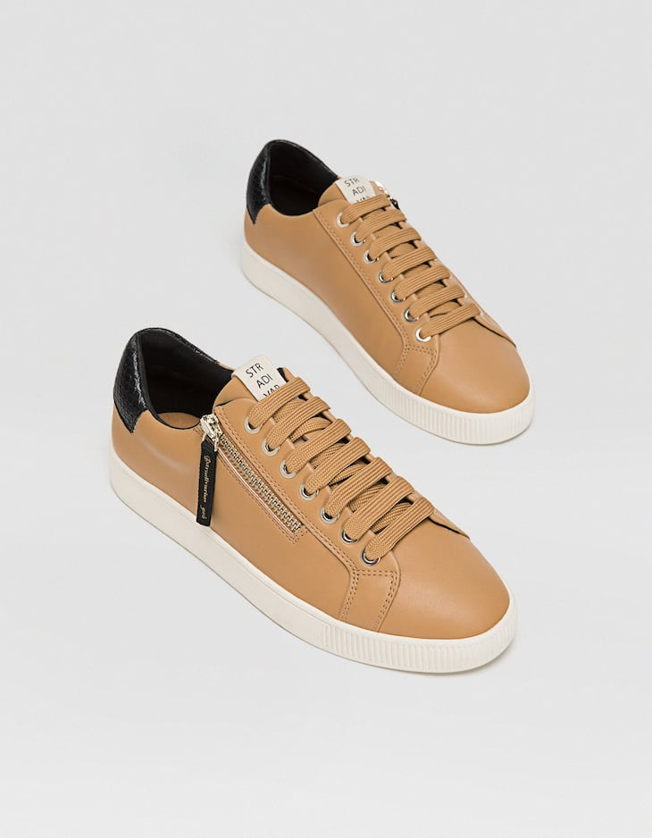 Brown zip-up trainers