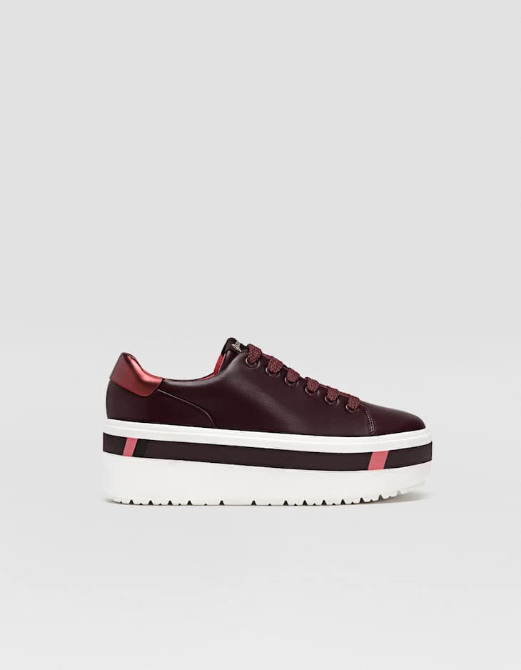Maroon trainers with contrasting platforms