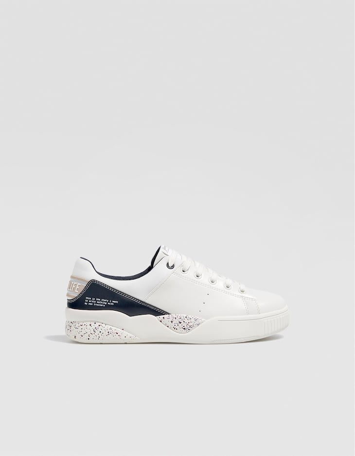 White plimsolls with detail