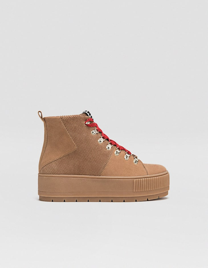 Tan corduroy mountain boots