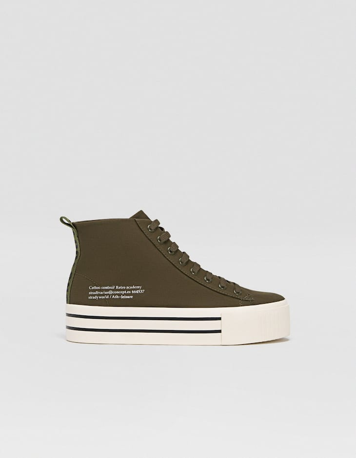 Green fabric high-top trainers