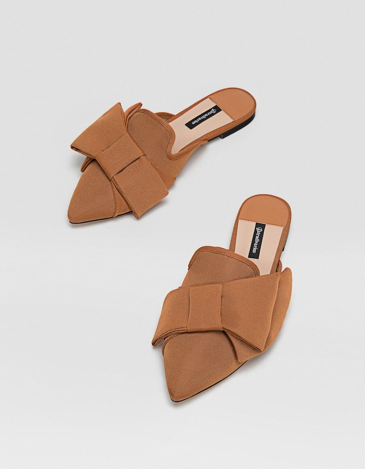 Brown mules with bow