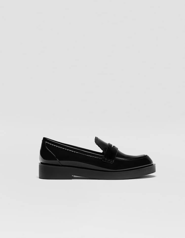Black platform loafers