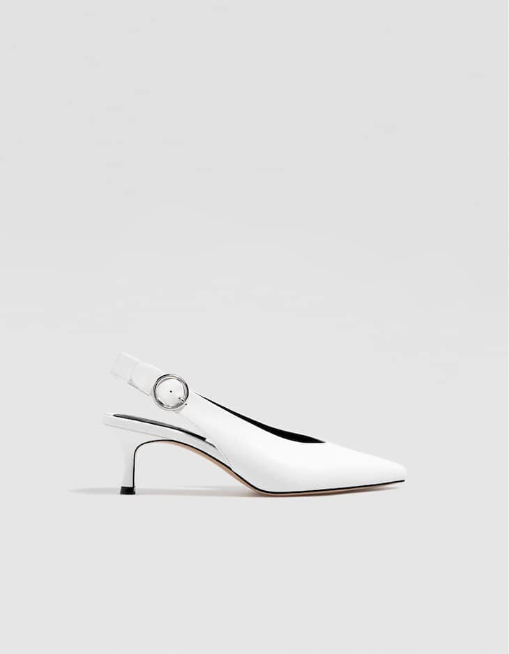 White slingback high-heel court shoes with buckle