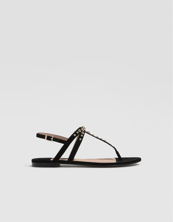 Black flat sandals with studs