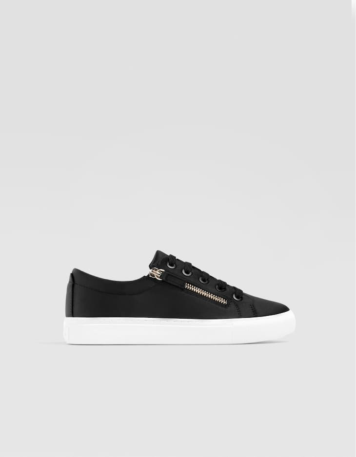 Black plimsolls with zip