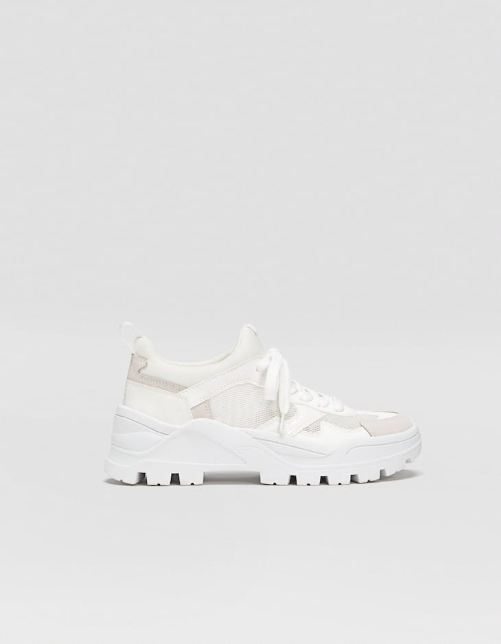 White trainers with track soles