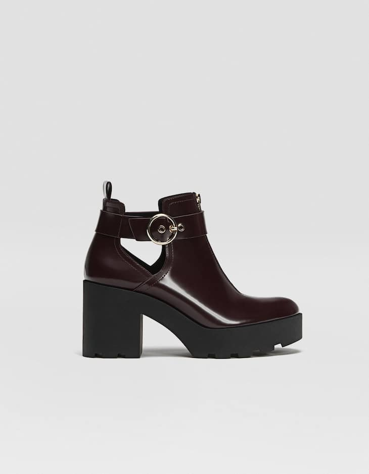 Ankle boots with openings and track soles