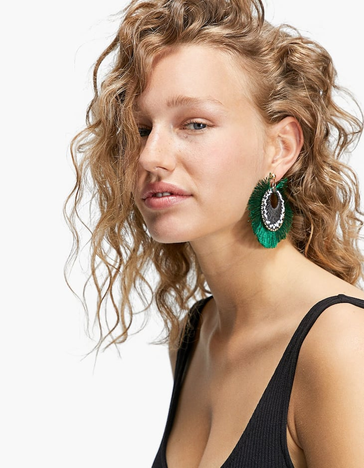 Earrings with large African-inspired fringing