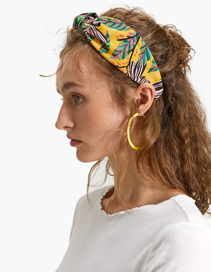 Rigid headband with flower and leaf print
