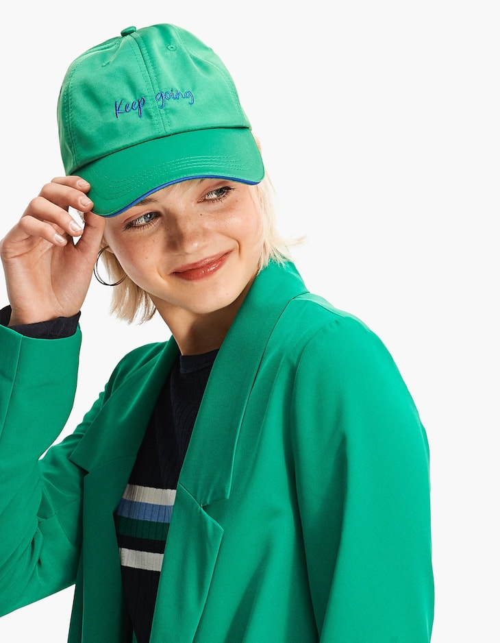 Green sateen cap with slogan