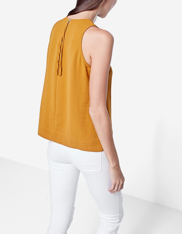 Top with top stitching detail