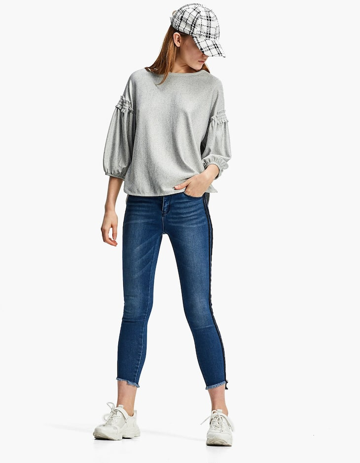 Baggy top with shoulder frill detail