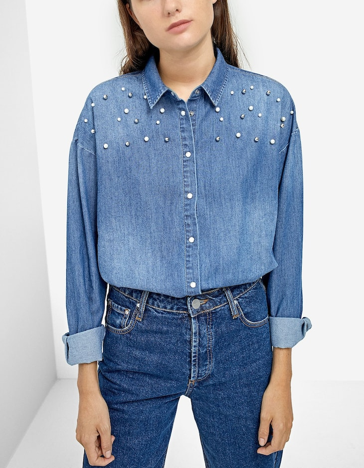 Denim shirt with faux pearl embellishment