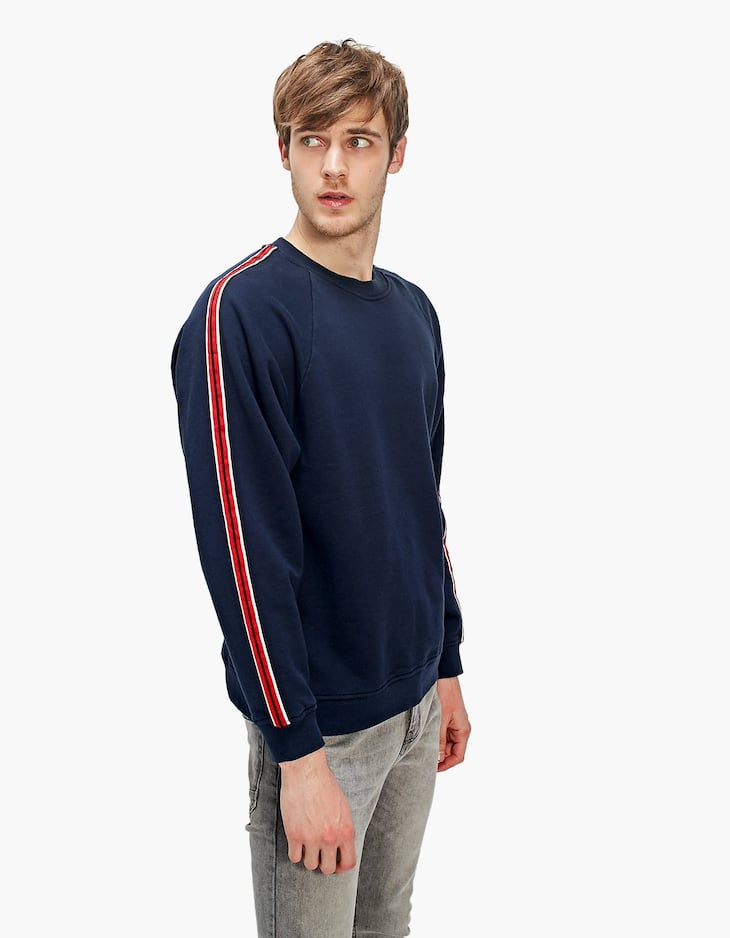 Raglan sleeve sweatshirt with strips on the sleeves