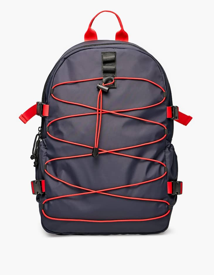 Backpack with elastic crossover straps