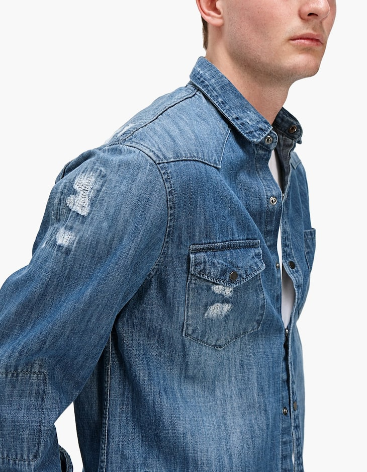Ripped denim shirt
