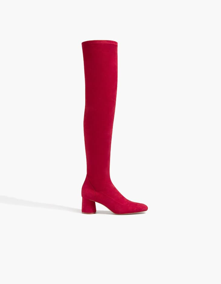 Red over-the-knee boots with high heels