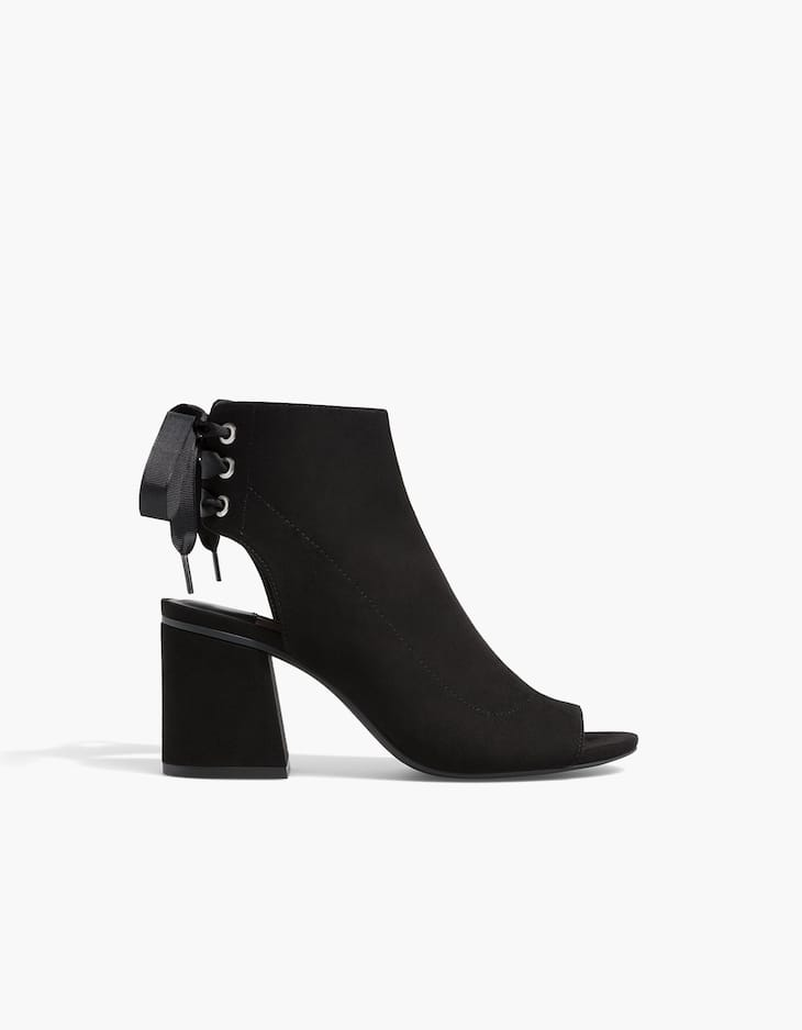 Black sandal-style ankle boots with lace-up detail