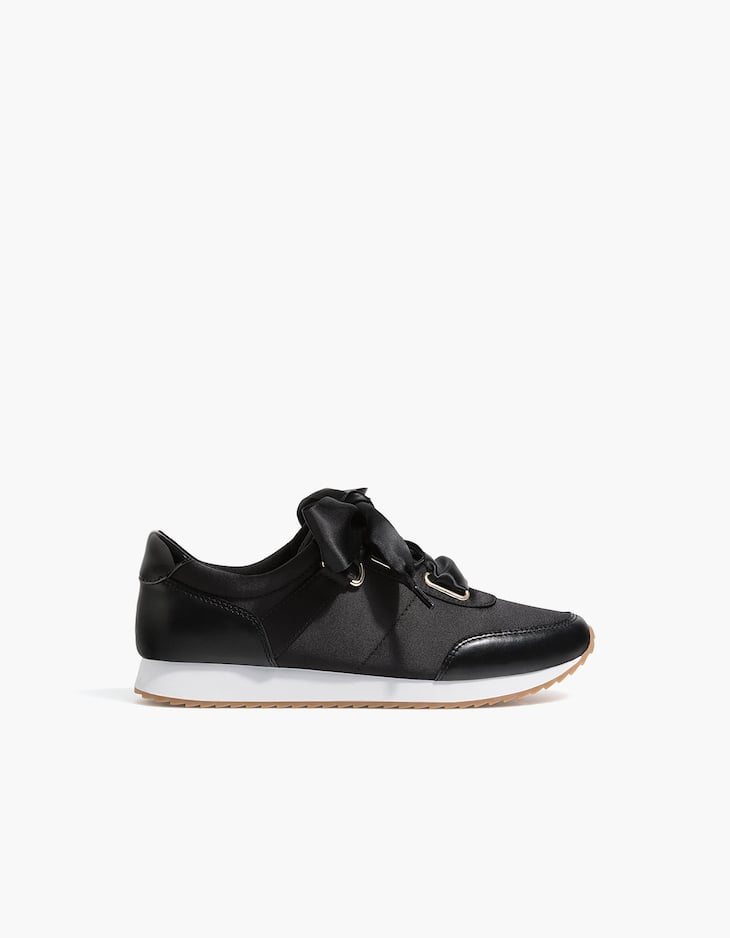 Black contrasting trainers with bows