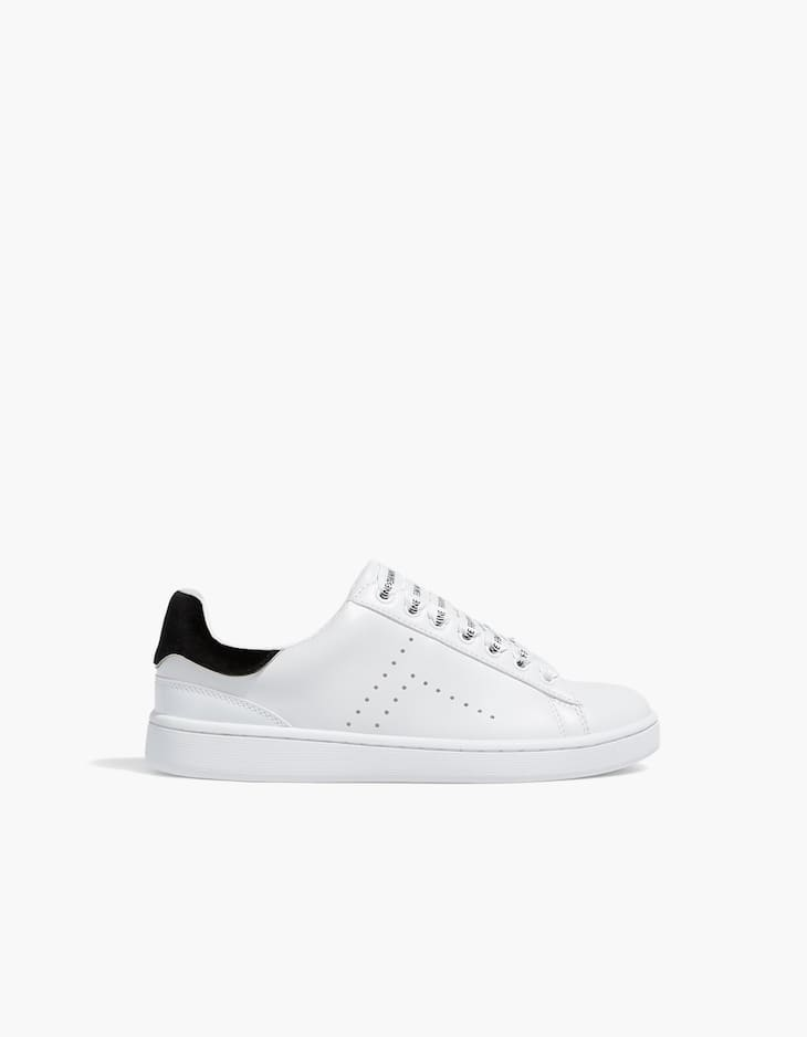 White trainers with slogan laces