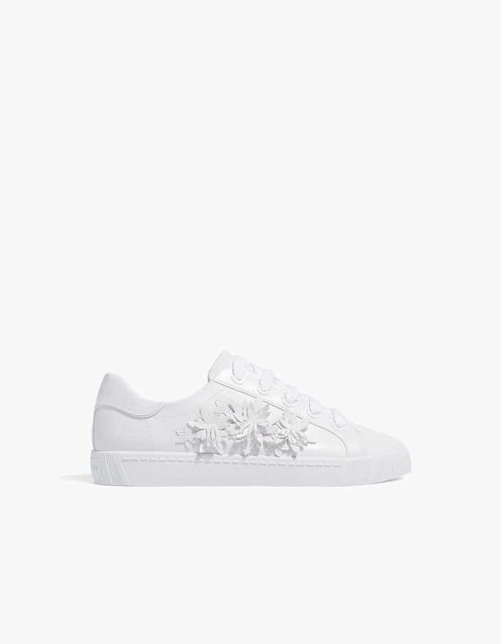 White plimsolls with floral details