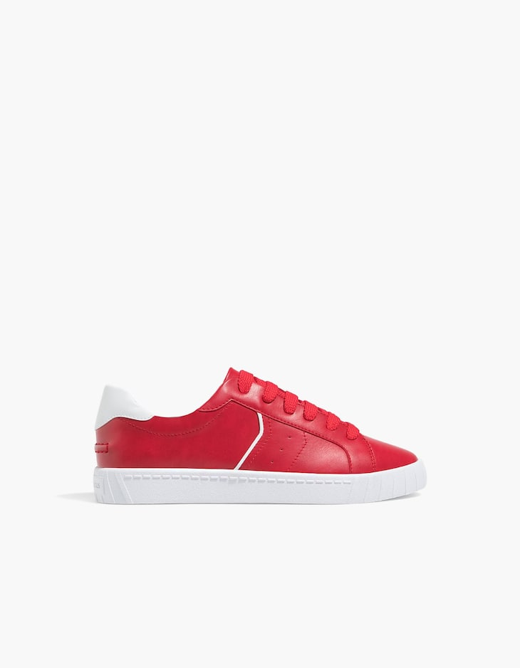 Red lace-up plimsolls