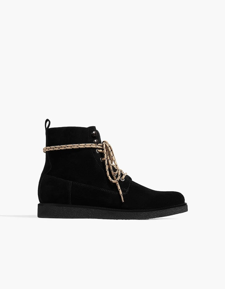 Black leather lace-up ankle boots