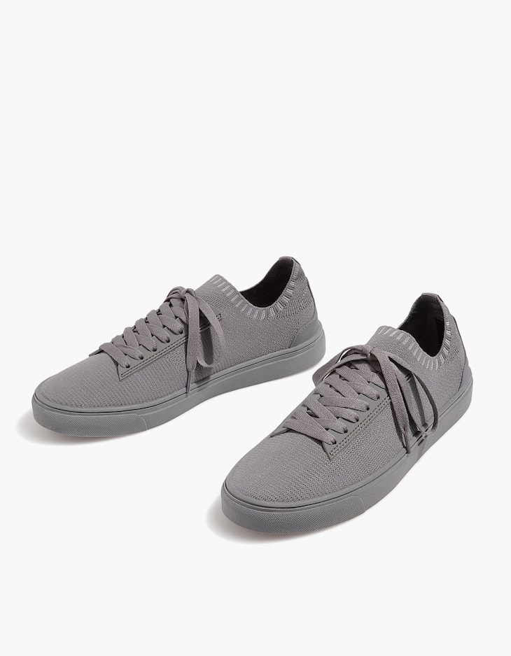 Monochrome grey fabric plimsolls