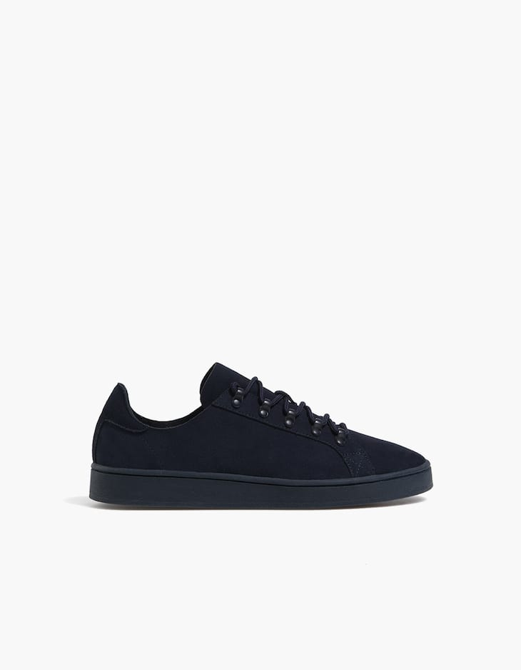 Blue leather plimsolls