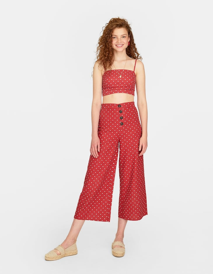 Cropped button-up polka dot trousers