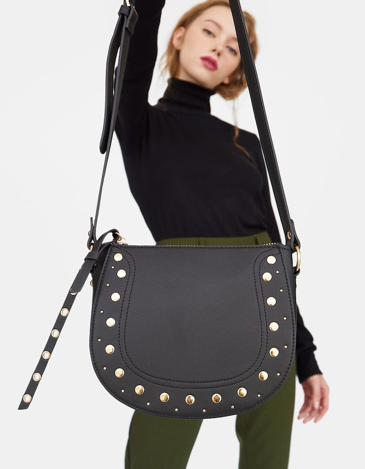 Crossbody saddle bag with studs
